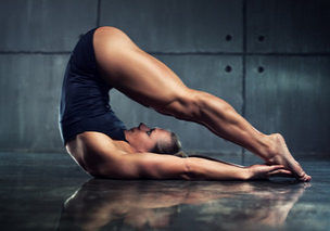42261121 - strong woman bodybuilder stretching upside down in urban interior.